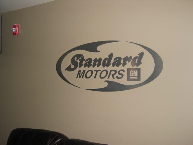 Vinyl wall graphics Standard Motors
